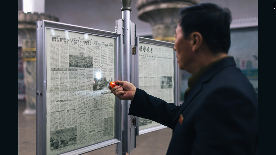 """However, as the platform itself was quite dim, this man brought his portable torch to read the newspaper,"" Li said."