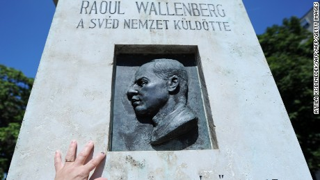 Wallenberg has been honored for his wartime efforts around the globe. He was awarded the US Congressional Gold medal in 2012. Pictured, a woman touches his memorial in Budapest.