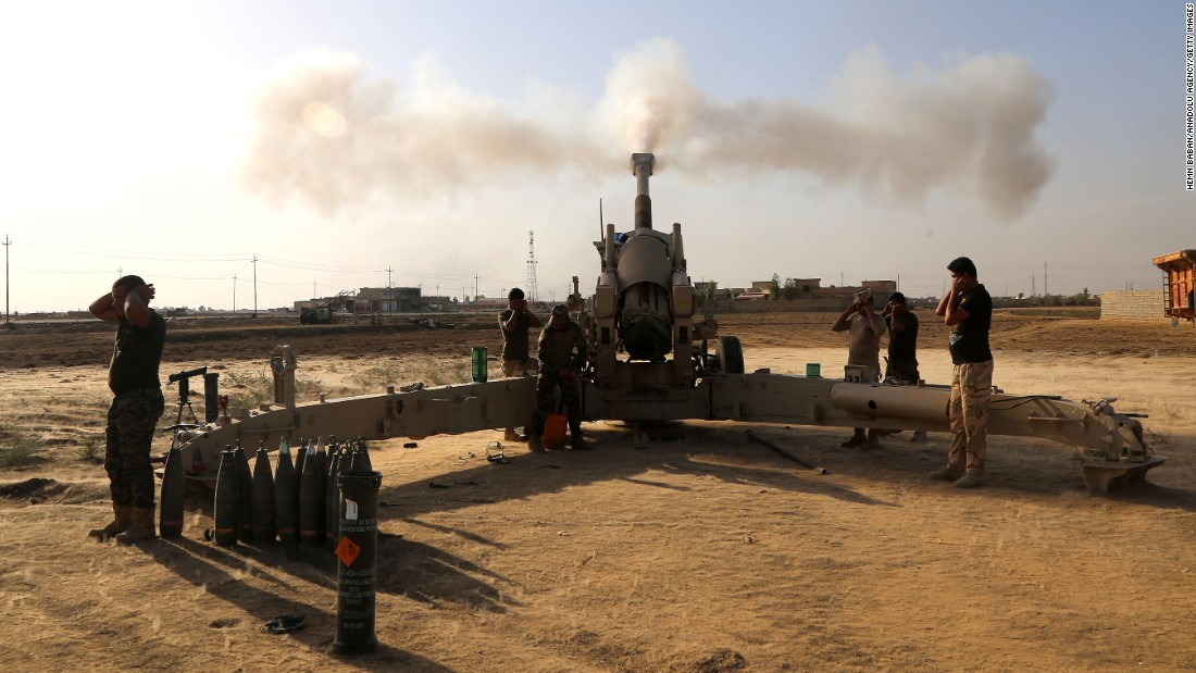 Iraqi forces fire artillery at ISIS targets on the Bartella front on November 1.