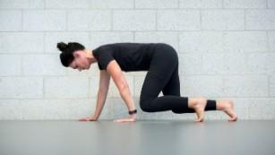 Danielle Johnson demonstrates how to crawl for exercise.