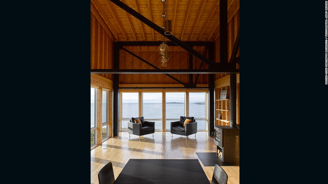 MacKay-Lyons Sweetapple Architects' graceful design includes a south-facing deck, wood and metal interiors, and floor-to-ceiling windows that overlook the sea.