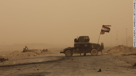 MOSUL, IRAQ - NOVEMBER 01: A view of Mosul-Erbil Highway, secured by Iraqi army members, during a sandstorm near Tehrawa village between Bertilla and Kokceli, as the operation to retake Iraq's Mosul from Daesh terrorists continues in Mosul, Iraq on November 1, 2016.  (Photo by Hemn Baban/Anadolu Agency/Getty Images)