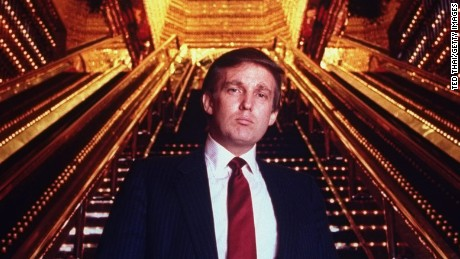 Real estate tycoon Donald Trump poised in Trump Tower atrium.