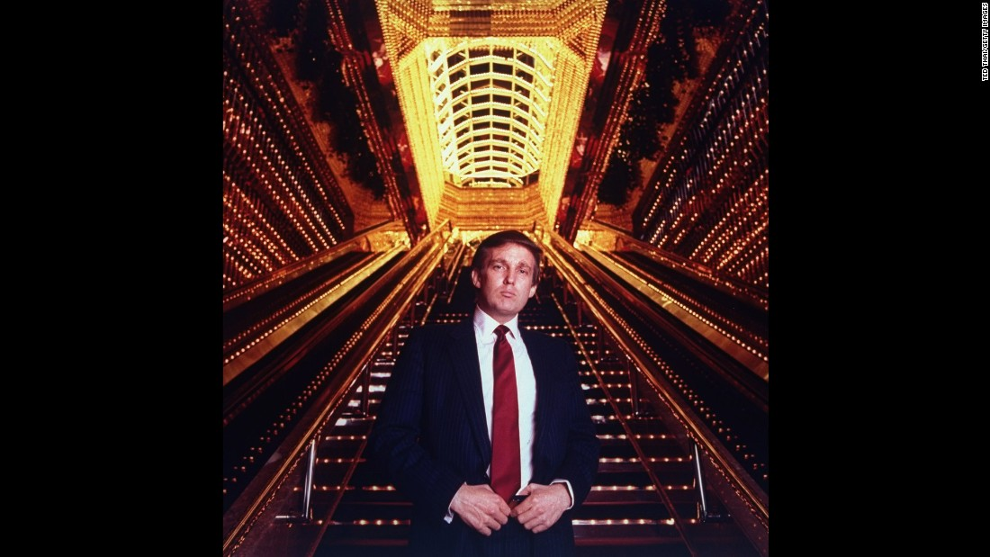 Trump stands in the atrium of the Trump Tower.