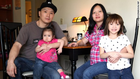 Korean adoptee Adam Crapser, left, with daughters, Christal and Christina and his wife, Anh Nguyen, in their Vancouver, Washington home.