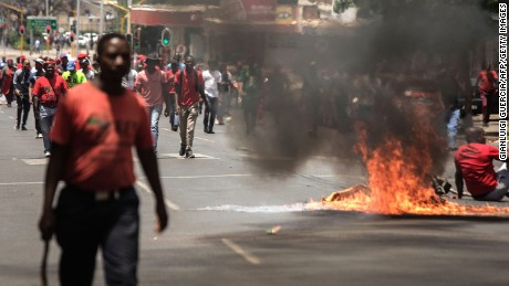 Garbage burns in the road during a demonstration Wednesday in Pretoria, South Africa.