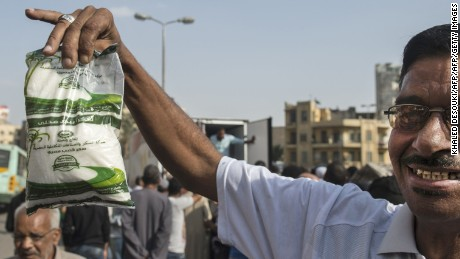 An Egyptian man shows a bag of sugar he just bought from a truck in the capital Cairo on October 26, 2016, as the country suffers from a sugar shortage. With two presidents deposed in six years, political turmoil has left the Egypt's economy in deep crisis. The country, its latest President Abdel Fattah al-Sisi has suggested, is facing a moment of truth when tough, long-deferred economic reforms can no longer be avoided. Sugar is only the latest good to see shortages -- before it was rice, cooking oil, baby formula and medicines. / AFP / KHALED DESOUKI        (Photo credit should read KHALED DESOUKI/AFP/Getty Images)