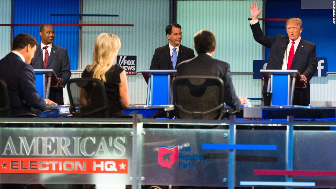 "Trump raises his hand during <a href=""http://www.cnn.com/2015/08/07/politics/gallery/republican-debate-2-gop-presidential-2016/index.html"" target=""_blank"">the first Republican debates</a> of the campaign, which took place in Cleveland on August 6, 2015. Trump kicked off the event by refusing to rule out a third-party run and pledge his support to whoever becomes the Republican nominee. He was joined on stage by nine other candidates -- seven of the lower-polling candidates <a href=""http://www.cnn.com/2015/08/06/politics/gallery/republican-debate-1-gop-presidential-2016/index.html"" target=""_blank"">had a separate debate</a> before the main event."