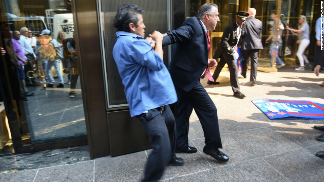 "Keith Schiller, Trump's director of security and longtime bodyguard, holds back demonstrator Efrain Galicia at Trump Tower in New York on September 3, 2015. Galicia was among five protesters who later <a href=""http://www.cnn.com/2015/09/09/politics/donald-trump-protesters-lawsuit/index.html"" target=""_blank"">filed a lawsuit</a> against Schiller, Trump, Trump's campaign and his company. The plaintiffs allege that Trump security officials, namely Schiller, assaulted them as they protested outside of a campaign event. A campaign spokesperson <a href=""https://www.washingtonpost.com/politics/trump-security-detail-makes-headlines-just-like-the-candidate/2015/09/04/1b2333ce-5335-11e5-933e-7d06c647a395_story.html"" target=""_blank"">told The Washington Post</a> that the protesters ""were harassing people on the street"" and that a Trump security guard was ""jumped from behind."""