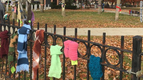 The brightly colored scarves and mittens adorn Veterans Memorial Park in Manchester.
