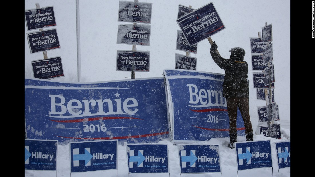 "A campaign worker brushes snow off Sanders signs in Manchester, New Hampshire, on February 5, 2016. Sanders <a href=""http://www.cnn.com/2016/02/09/politics/new-hampshire-primary-highlights/"" target=""_blank"">won the New Hampshire primary</a> a few days later."