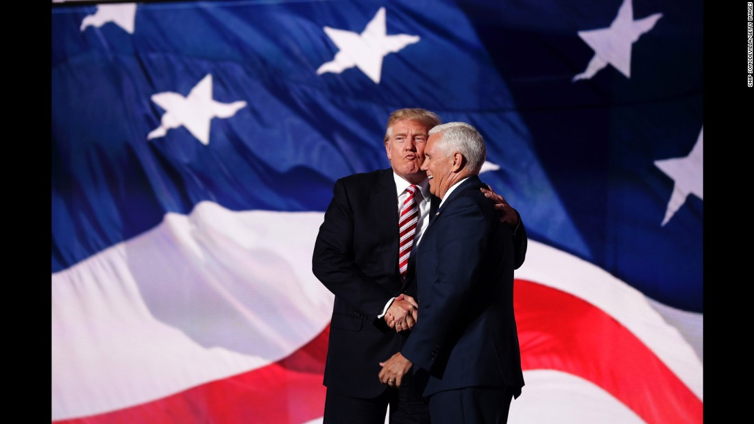"Trump <a href=""http://www.cnn.com/2016/07/21/politics/donald-trump-mike-pence-air-kiss/index.html"" target=""_blank"">gives an ""air kiss""</a> to his running mate, Indiana Gov. Mike Pence, after Pence's speech at the convention on July 20, 2016."