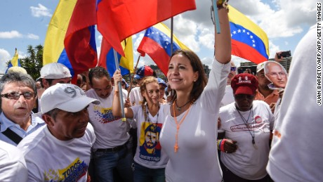 Venezuelan opposition ex-congresswoman Maria Corina Machado(c) and Lilian Tintori (L), wife of Venezuelan jailed opposition leader Leopoldo Lopez march during a demonstration in Caracas on October 22, 2016 A group of women, led by Lilian Tintori, wife of imprisoned opposition Leopoldo Lopez, march in Caracas to protest the suspension of the recall referendum against President Nicolas Maduro as the opposition considered a breach of constitutional order. / AFP / JUAN BARRETO        (Photo credit should read JUAN BARRETO/AFP/Getty Images)