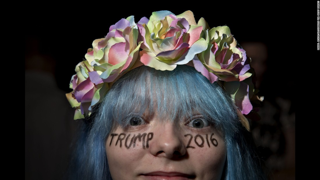 A Trump supporter waits for the start of a campaign event in Des Moines, Iowa on September 13, 2016.
