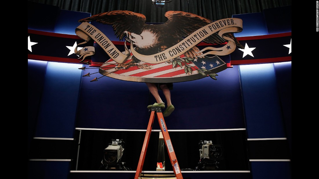 "Workers prepare the stage for <a href=""http://www.cnn.com/2016/10/09/politics/gallery/second-presidential-debate/index.html"" target=""_blank"">the second presidential debate,</a> which took place in St. Louis on October 7, 2016."