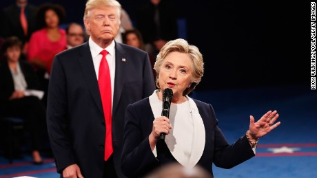 ST LOUIS, MO - OCTOBER 09:  Democratic presidential nominee former Secretary of State Hillary Clinton (R) speaks as Republican presidential nominee Donald Trump looks on during the town hall debate at Washington University on October 9, 2016 in St Louis, Missouri. This is the second of three presidential debates scheduled prior to the November 8th election.  (Photo by Rick Wilking/Pool/Getty Images)