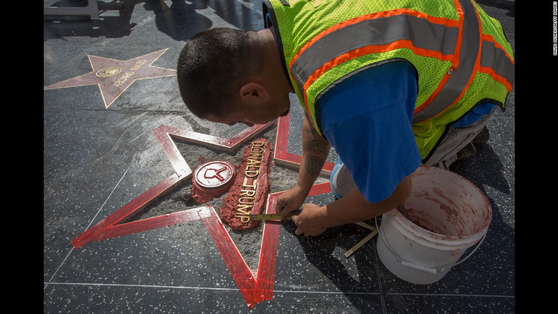 "Workers repair Trump's star on the Hollywood Walk of Fame after <a href=""http://www.cnn.com/2016/10/26/politics/hollywood-star-donald-trump-vandalism/index.html"" target=""_blank"">it was vandalized</a> on October 26, 2016."