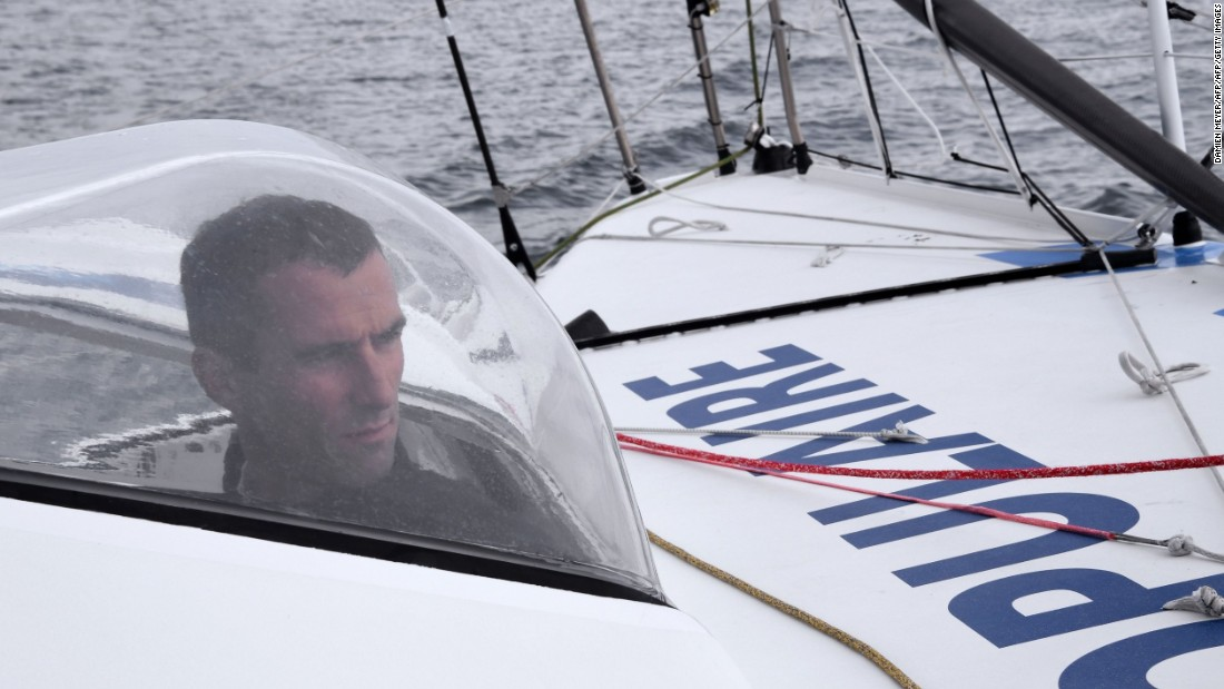 Protected from the elements -- French skipper Armel le Cleac'h on Banque Populaire off the Port-la-Foret coast, western France. Not yet 40, he has already been a runner-up twice in the Vendee Globe.