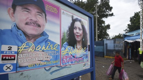 A boy walks next to propaganda of Nicaraguan President Daniel Ortega and her wife Rosario Murillo in Managua on November 2, 2016, ahead of the general elections to take place next November 6. Surveys indicate that Nicaragua's first couple are more than likely to emerge the winners of elections that will hand Ortega a fourth mandate, and Murillo her first as his vice president. / AFP / RODRIGO ARANGUA        (Photo credit should read RODRIGO ARANGUA/AFP/Getty Images)