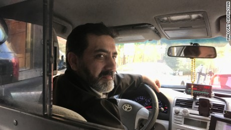Syed Badshah, 44, has been shuttling residents to and from work.