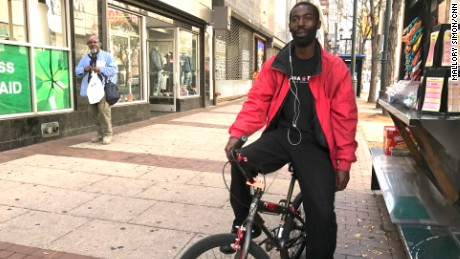 Nafis Mumin, 38, rides his 9-year-old son's bike to work.