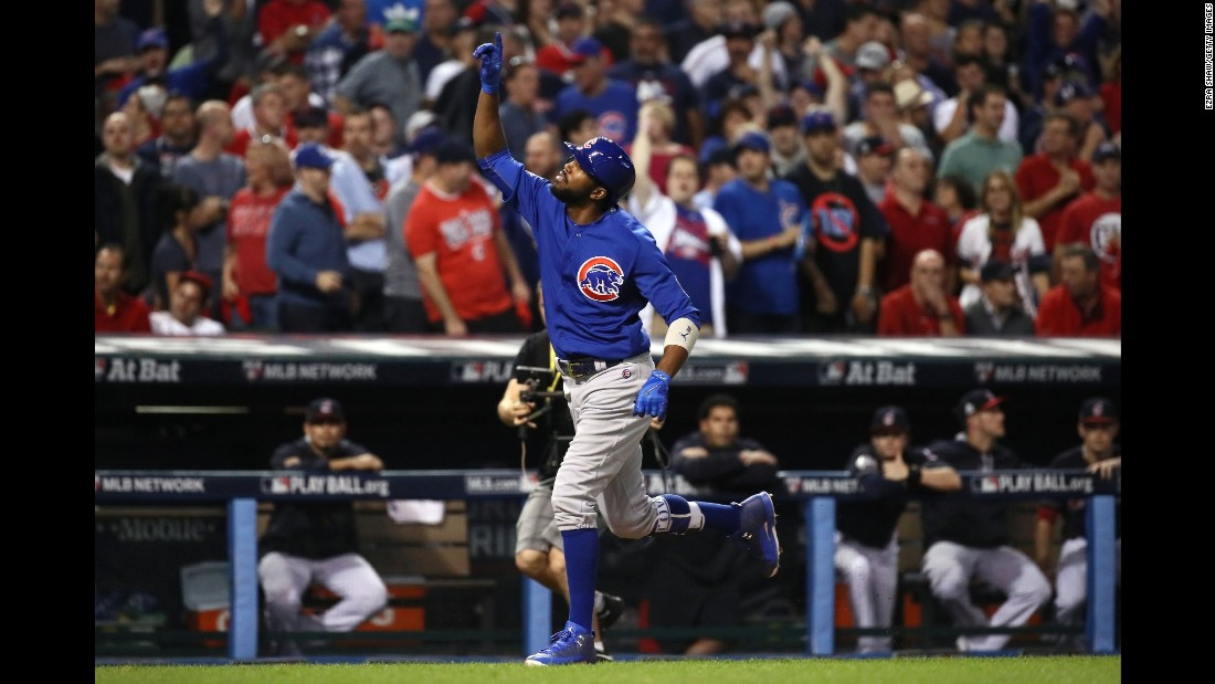Dexter Fowler of the Cubs celebrates after hitting a lead off home run in the first inning of Game 7.
