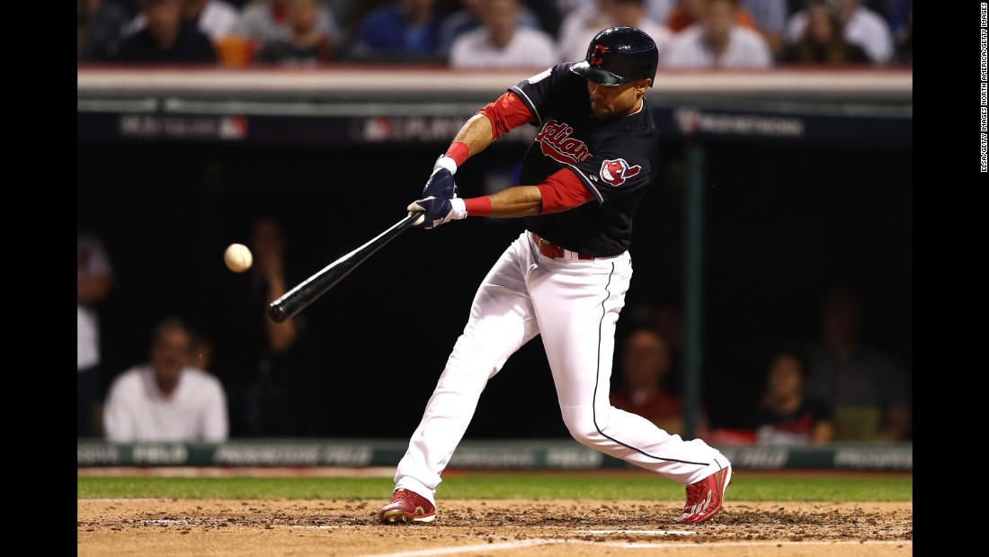 Coco Crisp of the Indians hits a double during the third inning in Game 7.