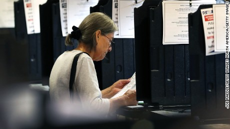 MIAMI, FL - OCTOBER 31: A voter casts her vote at an early voting center setup for the general election on October 31, 2016 in Miami, Florida. The election features the presidential candidates Democrat Hillary Clinton and Republican Donald Trump. (Photo by Joe Raedle/Getty Images)