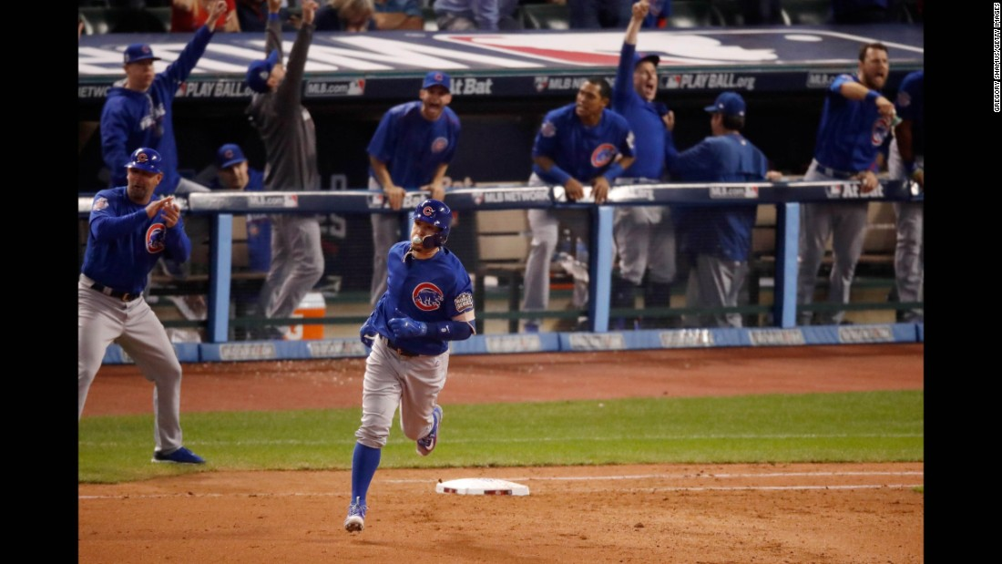 Javier Baez of the Cubs runs the bases after hitting a solo home run during the fifth inning in Game 7.