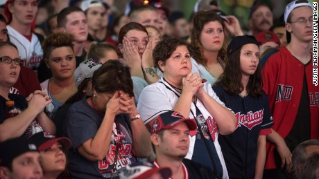 Cleveland Indians fans react as they watch the big screen outside of Progressive Field during game 7 of the World Series.