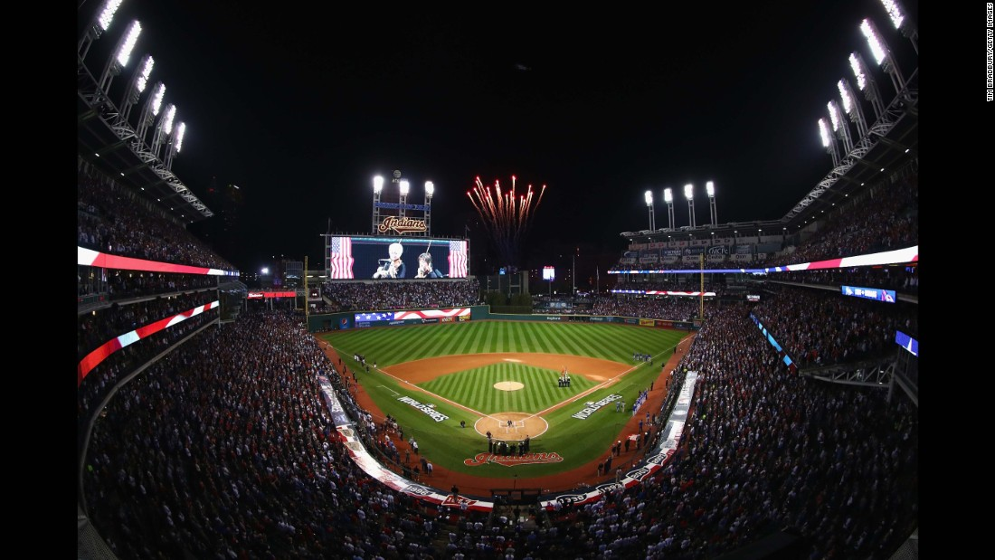 The Cleveland Indians and Chicago Cubs stand for the national anthem prior to Game 7.