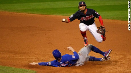 Francisco Lindor of the Cleveland Indians jumps over Chris Coghlan of the Chicago Cubs in the ninth inning in Game 7.