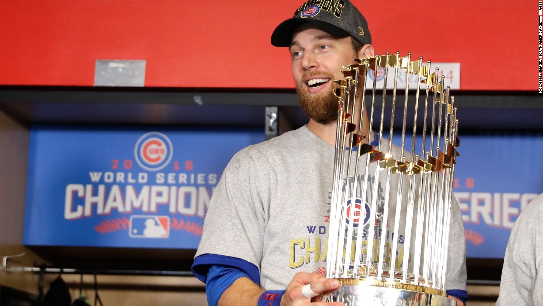 World Series MVP Ben Zobrist of the Cubs poses with The Commissioner's Trophy.