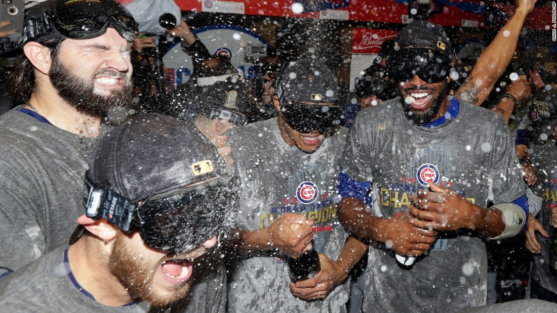 The Chicago Cubs celebrate in the locker room.