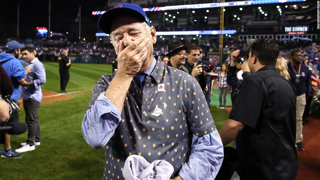 Bill Murray reacts on the field after the Cubs won.