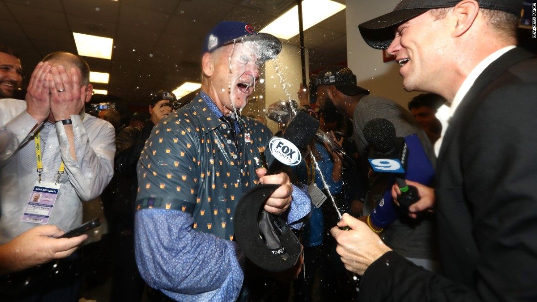 Actor Bill Murray, a longtime Cubs fan, celebrates in the winning clubhouse with Theo Epstein, the team's president of baseball operations.