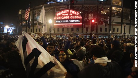 CHICAGO, IL - NOVEMBER 02:  Chicago Cubs fans celebrate outside Wrigley Field after the Cubs defeated the Cleveland Indians in game seven of the 2016 World Series on November 2, 2016 in Chicago, Illinois. The Cubs 8-7 victory landed them their first World Series title since 1908.  (Photo by Scott Olson/Getty Images)