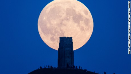 GLASTONBURY, UNITED KINGDOM - SEPTEMBER 27:  The supermoon rises behind Glastonbury Tor on September 27, 2015 in Glastonbury, England. Tonight's supermoon, so called because it is the closest full moon to the Earth this year, is particularly rare as it coincides with a lunar eclipse, a combination that has not happened since 1982 and won't happen again until 2033.  (Photo by Matt Cardy/Getty Images)