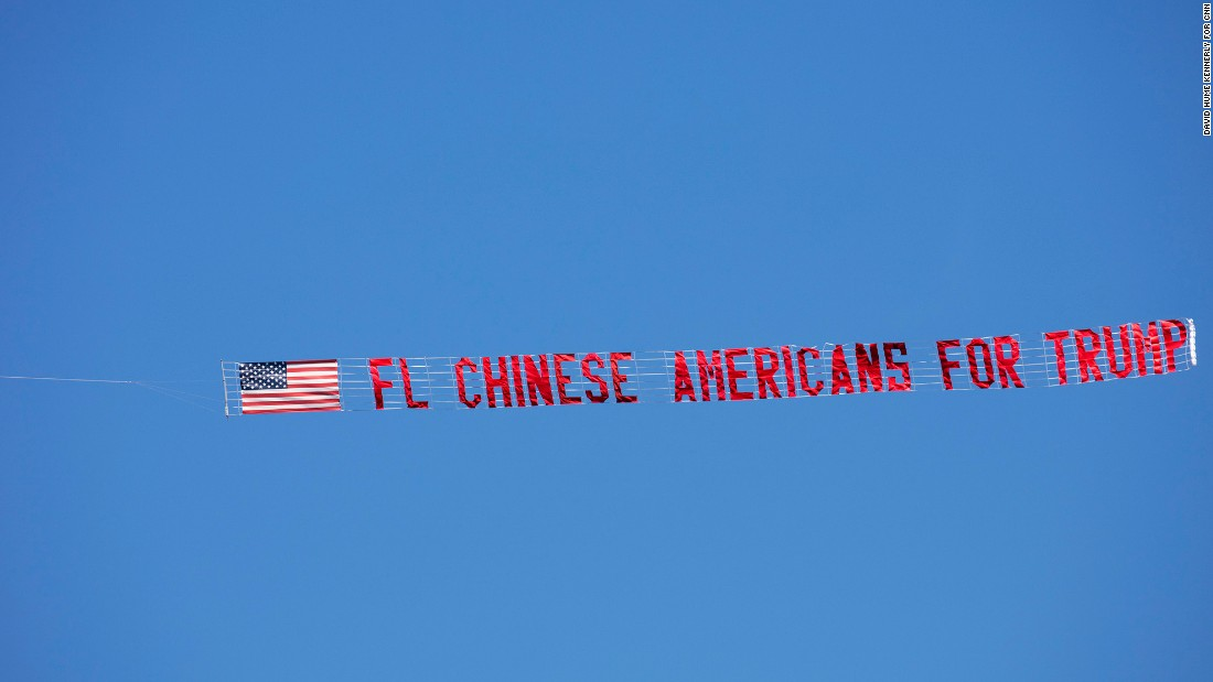 A banner flies overhead at a Trump rally in Orlando on November 2.