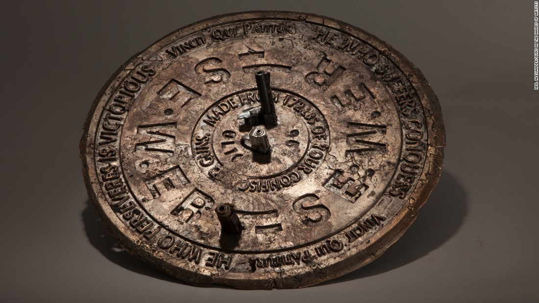 "Bradley McCallum smelted guns and shell casings to create this manhole cover. Gun violence has been a regular feature of his work he said, as ""our national policies have not changed, and even the most reasonable efforts to enact gun legislation face huge obstacles."""