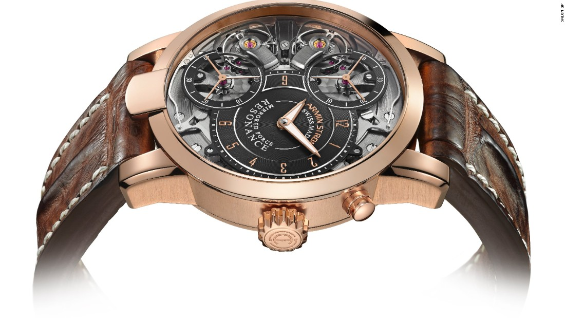 "<a href=""https://www.arminstrom.com/"" target=""_blank"">Armin Strom's</a> Mirrored Force Resonance contains two distinct movements for ultimate precision -- mechanisms proudly displayed through the dial. Its complimented with an alligator strap and rose gold hardware."