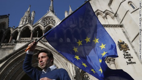 Phil Jones, 'People's Challenge' member waves an EU flag outside the Royal Courts of Justice on October 13, 2016 in London, England.