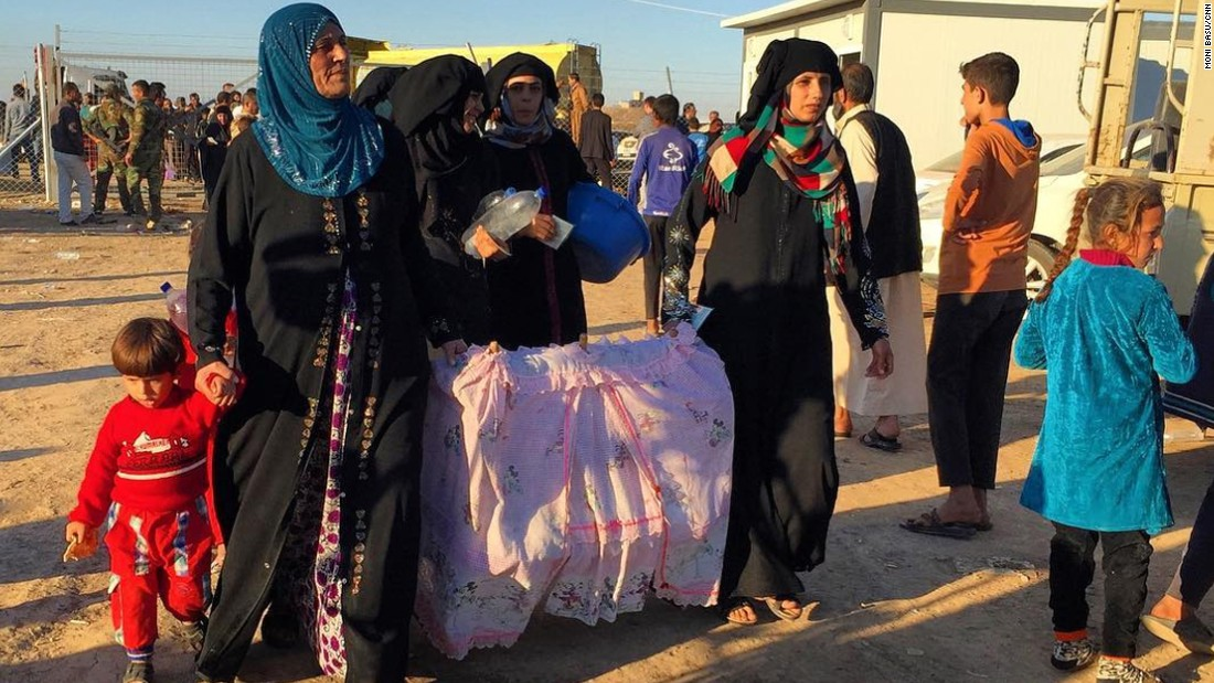 "Women and children arrived at the Khazir camp east of Mosul with stories of horror under ISIS.   A young man said ISIS had placed roadside bombs in front of their homes. ""There are snipers on the rooftops,"" he said. <br />"