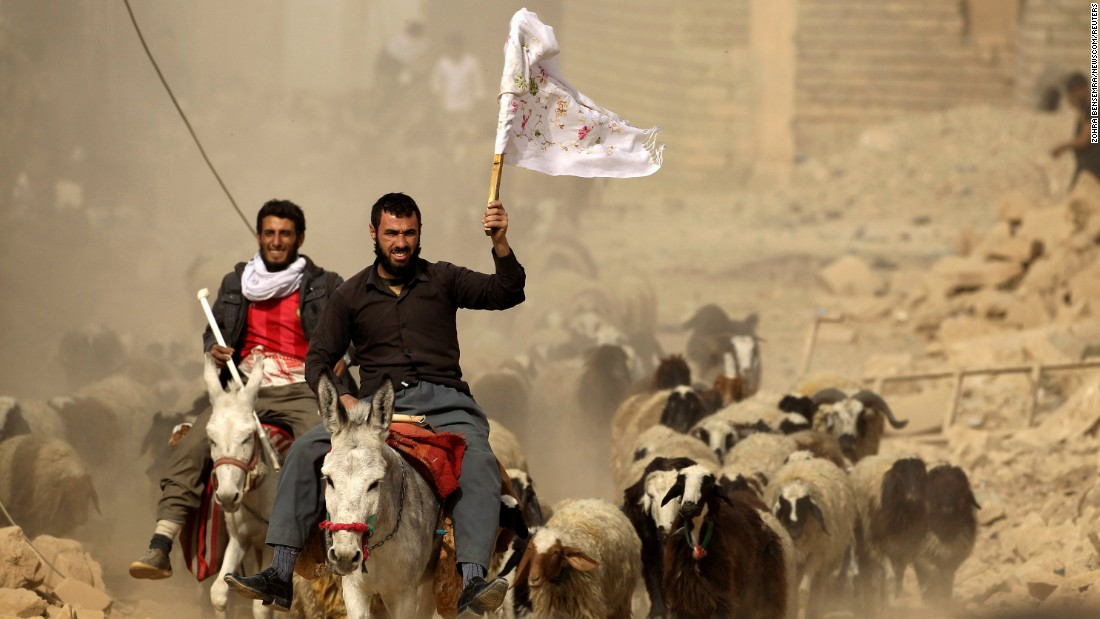 A man fleeing the village of Bazwaia carries a white flag as he arrives at a checkpoint on November 1.