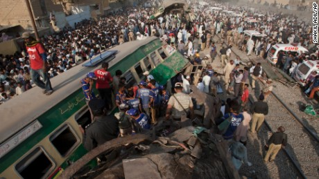 Bystanders search the wreckage for victims of a train crash in Karachi, Pakistan, November 3.