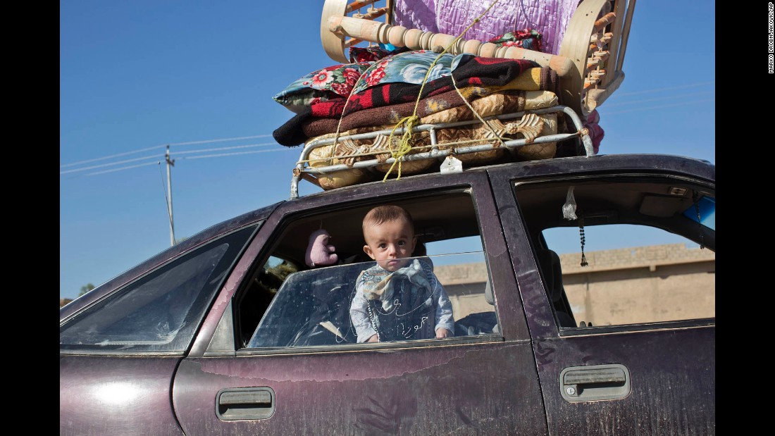 A child peers through a car window in the village of Bazwaya on November 3.