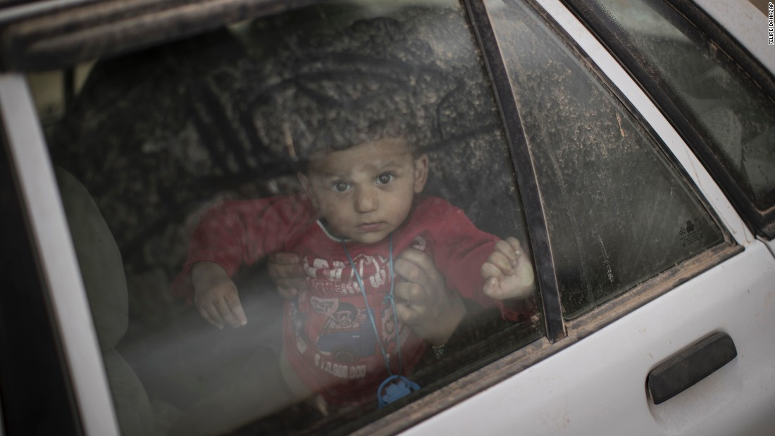 "A boy looks out from a car window at a checkpoint near Qayyara, south of Mosul, Iraq, on Tuesday, November 1. <a href=""http://www.cnn.com/2016/10/17/world/gallery/mosul/index.html"" target=""_blank"">An Iraqi-led offensive</a> is underway to reclaim Mosul, Iraq's second-largest city and the last major stronghold for ISIS in the country."