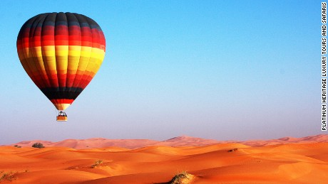 You can float over sand dunes at sunrise with Platinum Heritage.