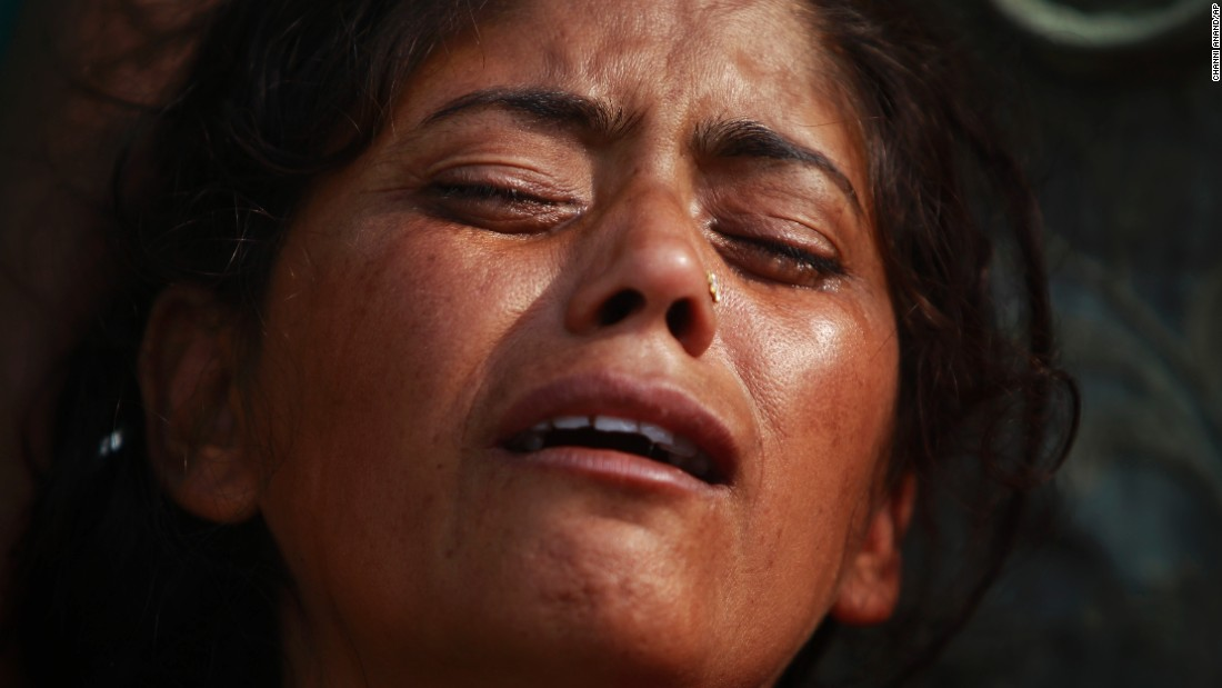 "A woman mourns her husband's death outside a hospital in Indian-controlled Kashmir on Tuesday, November 1. India and Pakistan said <a href=""http://www.cnn.com/2016/11/01/asia/india-pakistan-kashmir-deaths/"" target=""_blank"">13 civilians were killed in cross-border shelling</a> from both sides of the Line of Control, the de facto border between the two countries in Kashmir."