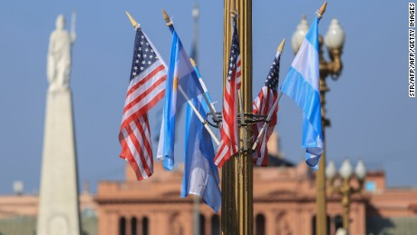 Photo released by Noticias Argentinas of Argentine and US flags adorning Mayo square in Buenos Aires on March 22, 2016. Deadly bomb blasts in Brussels prompted Argentina to raise its security alert level Tuesday as it prepared for a visit by US President Barack Obama. AFP PHOTO / NA / MARCELO CAPECE / AFP / NA / STR        (Photo credit should read STR/AFP/Getty Images)